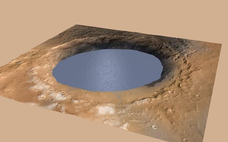 Esta ilustración muestra un lago de agua lleno parcialmente el Cráter Gale de Marte. Habría sido llenado por la escorrentía de la nieve derritiéndose en el borde norte del cráter. La evidencia de antiguos arroyos, deltas y lagos que el rover Curiosity de la NASA ha encontrado en los patrones de depósitos sedimentarios en Gale sugiere que el cráter albergó un lago como este hace más de tres mil millones de años, llenándose y secándose en múltiples ciclos durante decenas de millones de años. Credits: NASA/JPL-Caltech/ESA/DLR/FU Berlin/MSSS